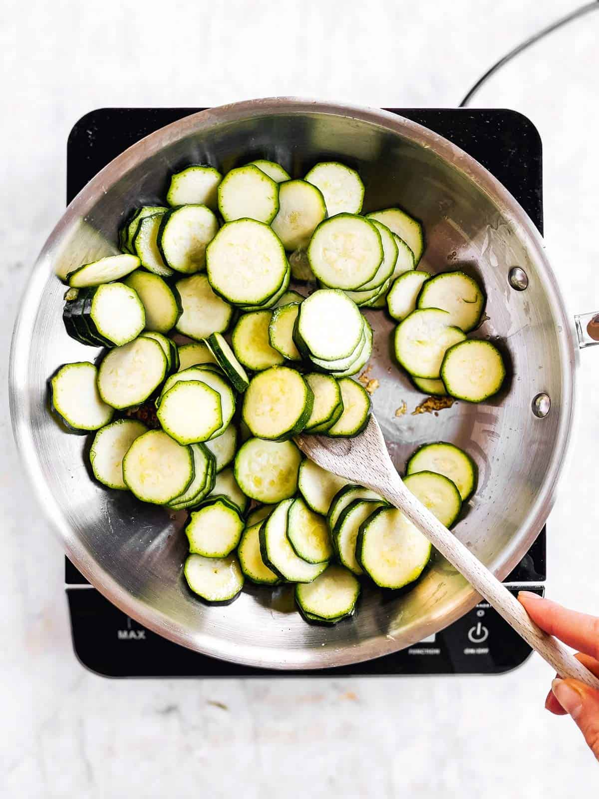 overhead view of raw zucchini slices in skillet