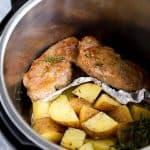 pork chops and potatoes inside an instant pot