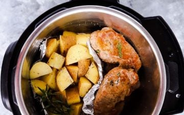 top down view of an instant pot filled with pork chops and potatoes
