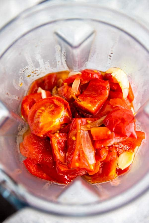 Vitamix blender with roasted tomatoes in it