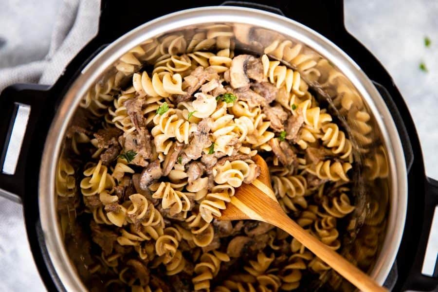 top down view of an instant pot filled with noodled and stroganoff