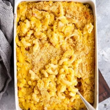 white baking dish with butternut squash mac and cheese