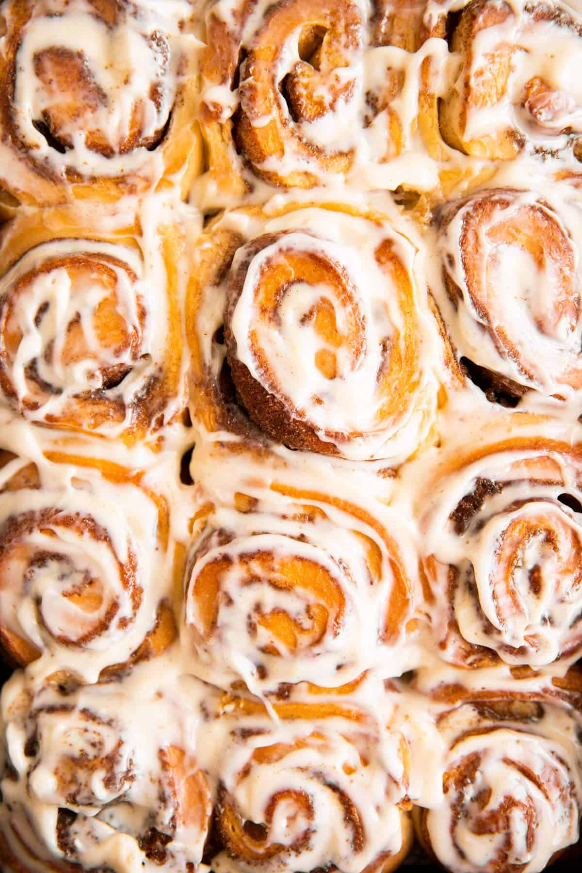 overhead view of frosted cinnamon rolls
