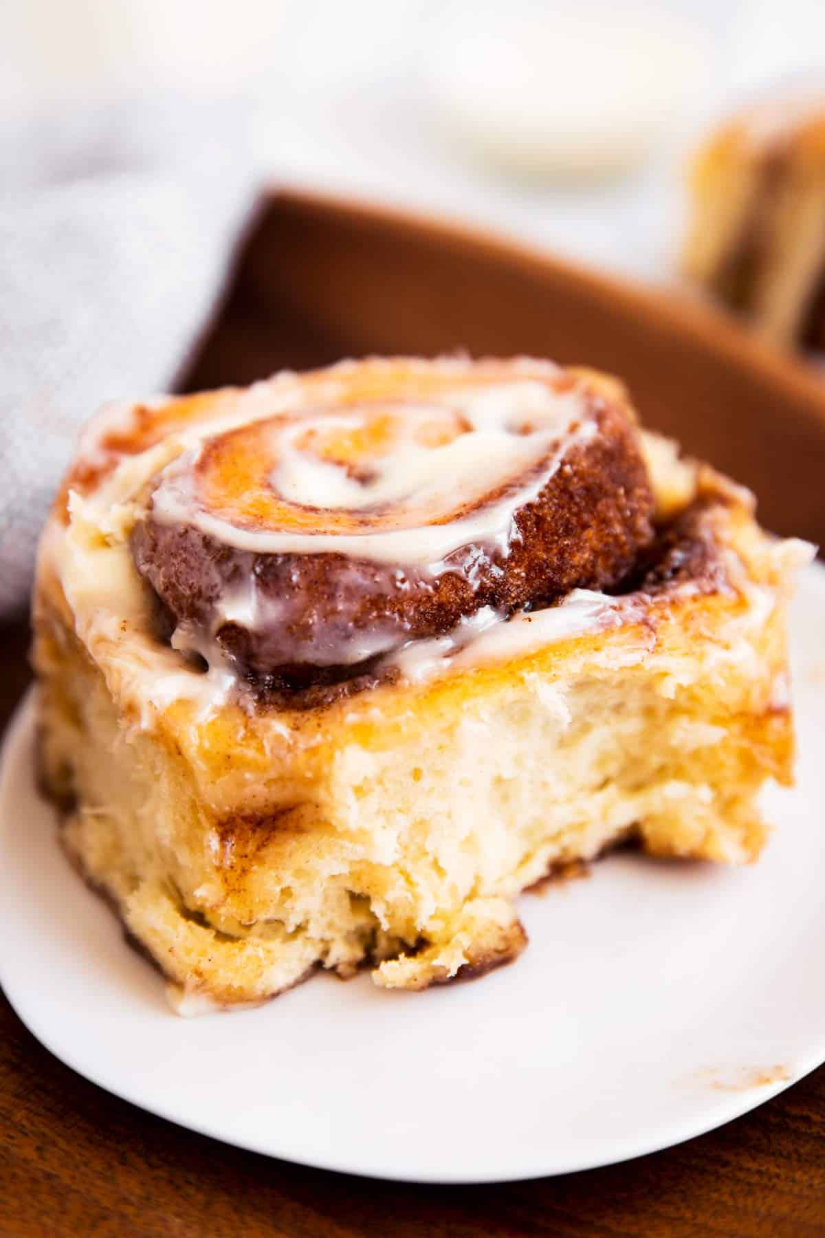 cinnamon roll sitting on white plate