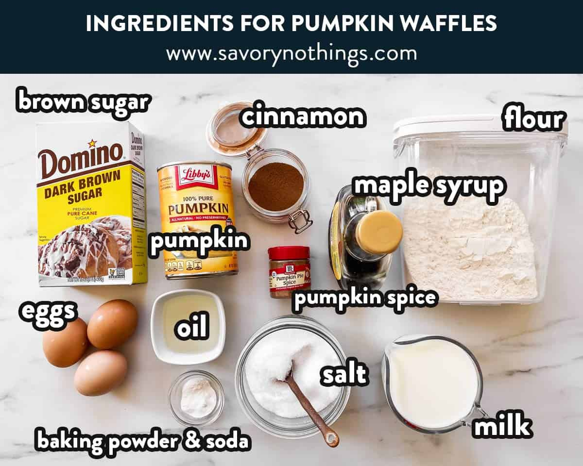 ingredients to make pumpkin waffles on a marble surface with text labels