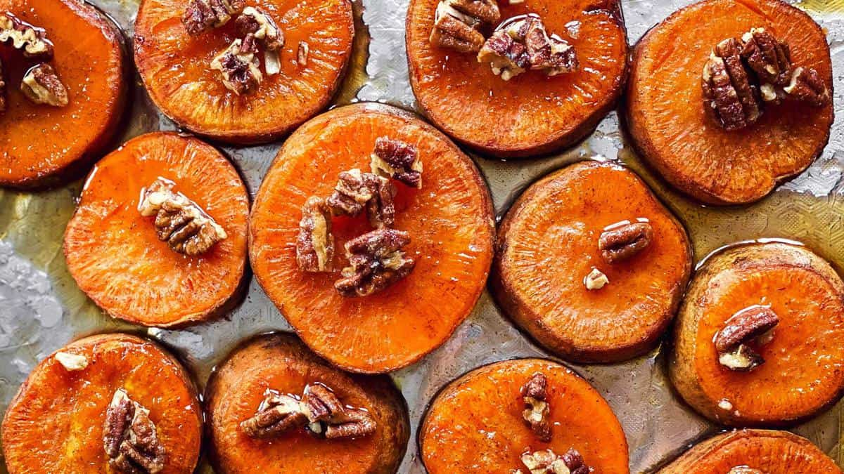 sheet pan with sliced roasted sweet potatoes