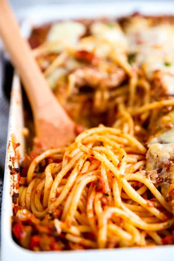 close up photo of spaghetti in a baking dish