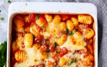 close up photo of white casserole dish with gnocchi bake
