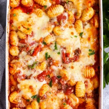white casserole dish with bolognese gnocchi bake