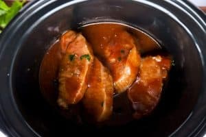top down view of pork chops in a slow cooker