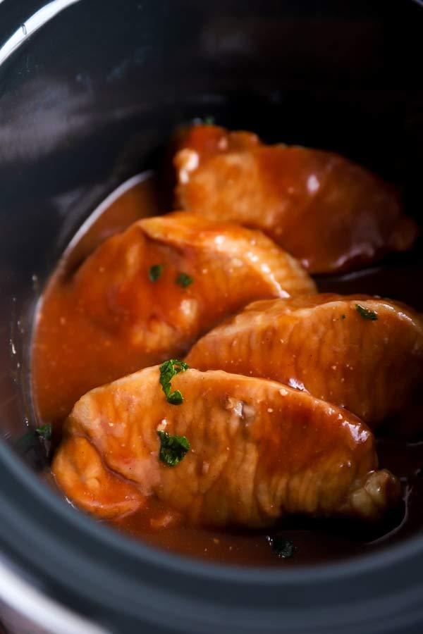 cranberry pork chops in a black crock