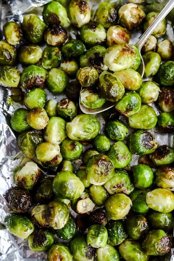 top down view of Roasted Brussels sprouts with garlic on a baking pan