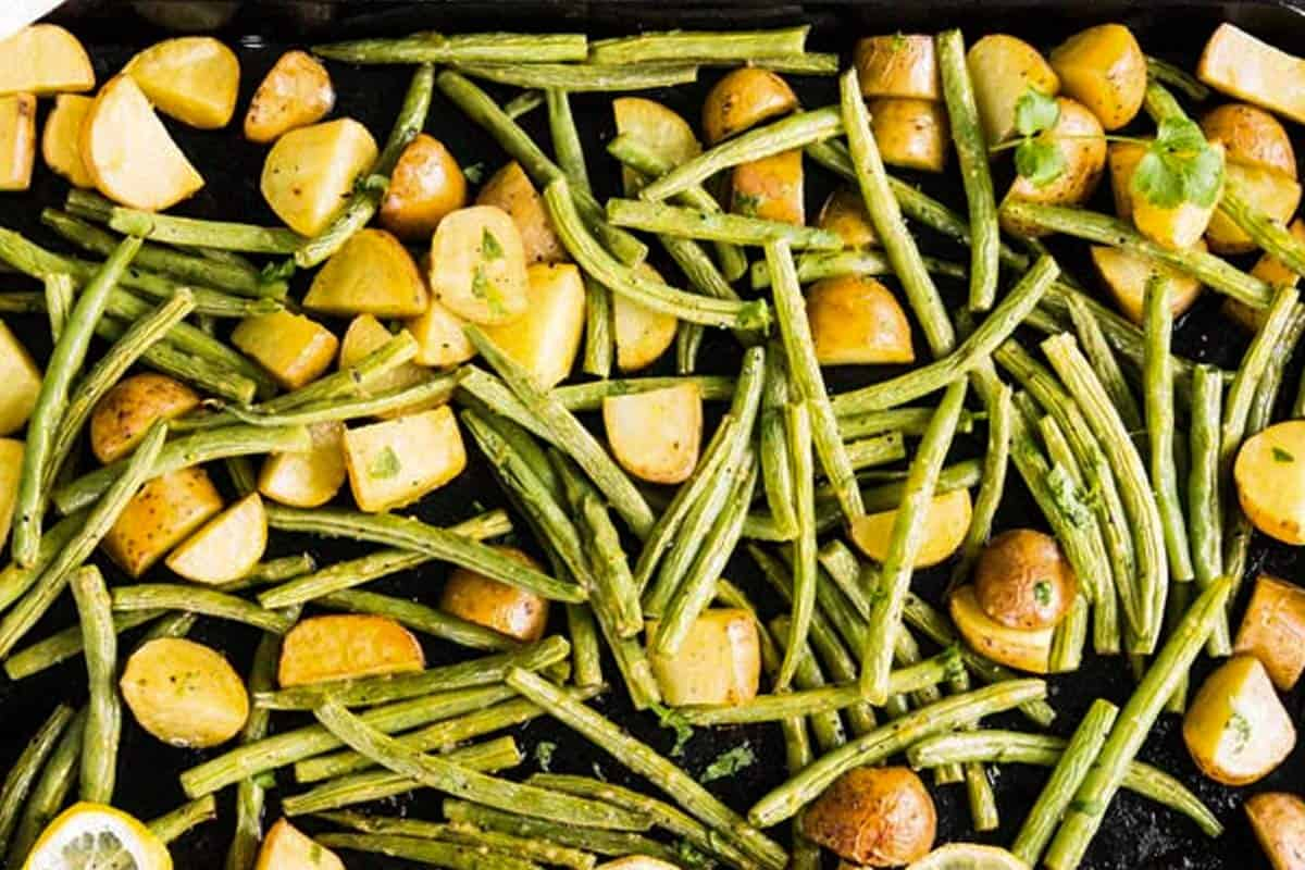 green beans and potatoes on sheet pan