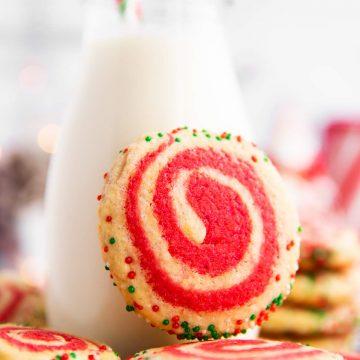 pinwheel cookie leaning against a milk bottle