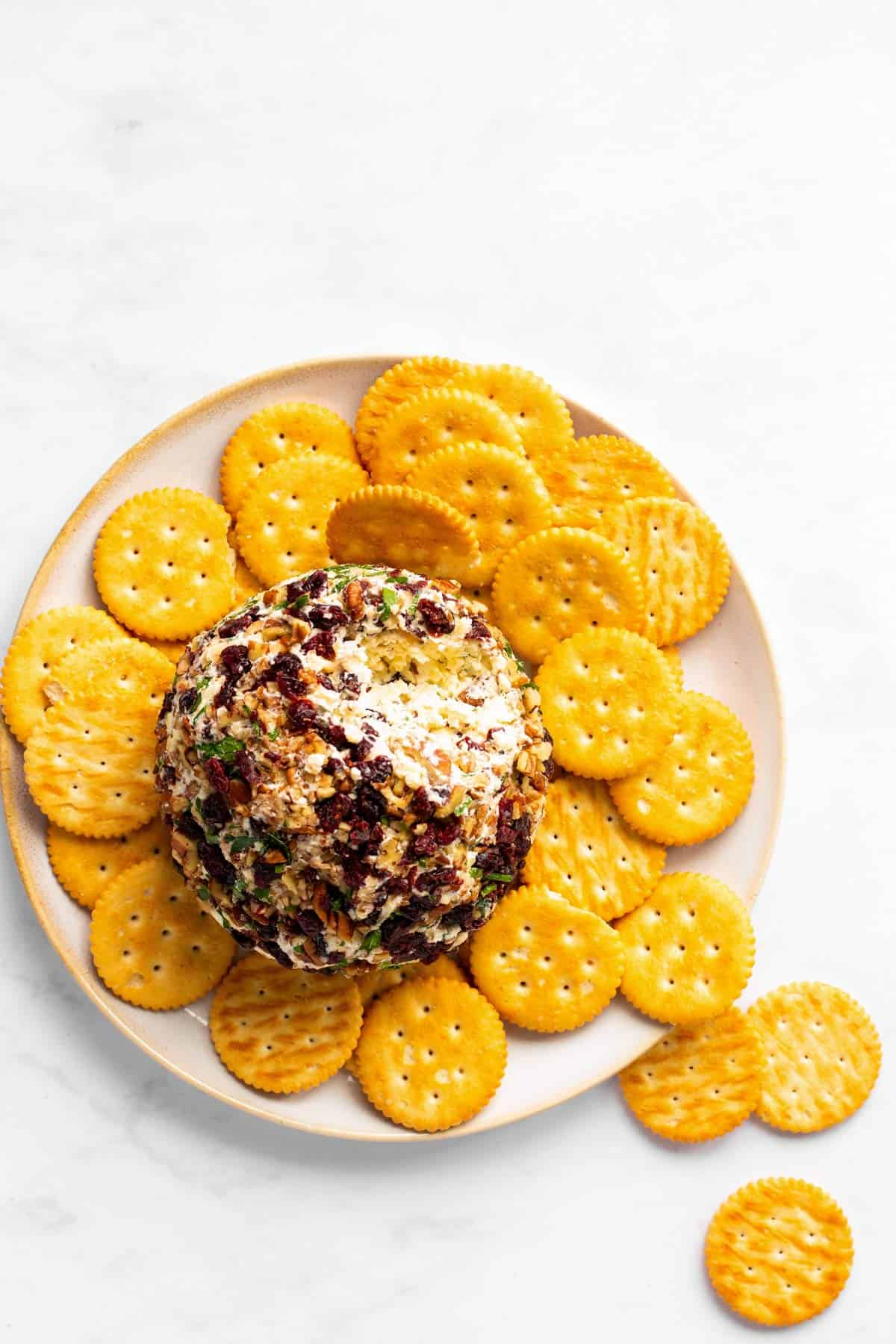 overhead view of platter with crackers and cheeseball