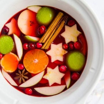 top down view of a white crock pot filled with Christmas punch