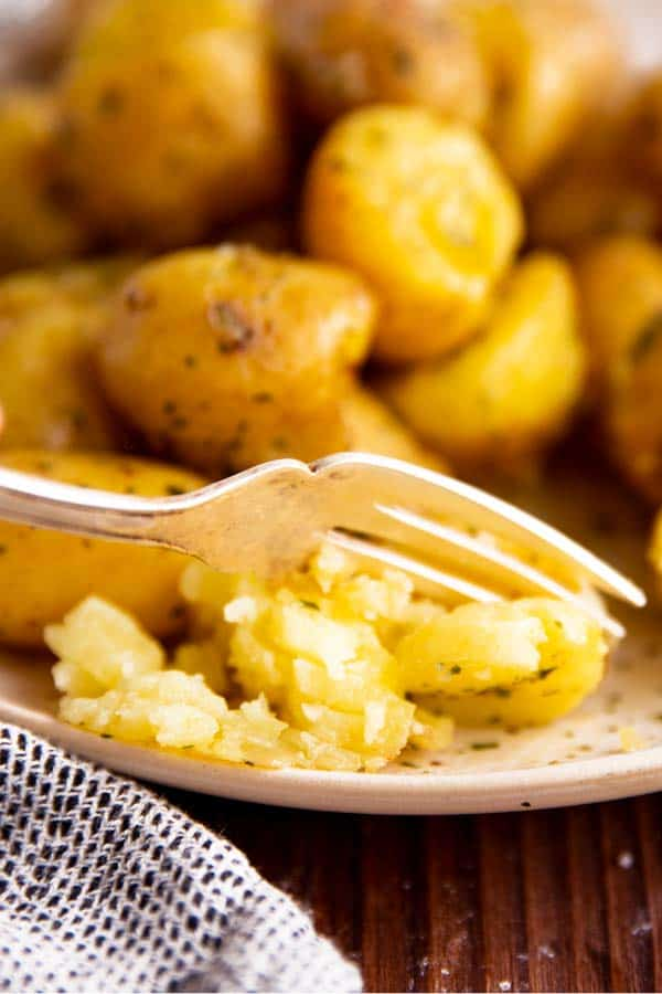 fork going through a fluffy potato