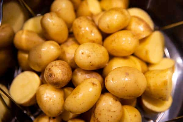 pile of raw baby potatoes in an instant pot