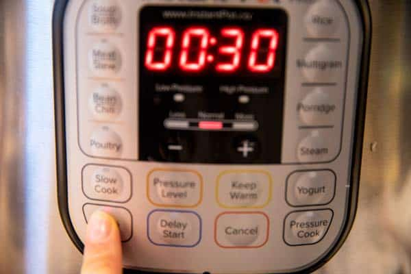 """pressing the """"sauté"""" button on an instant pot"""