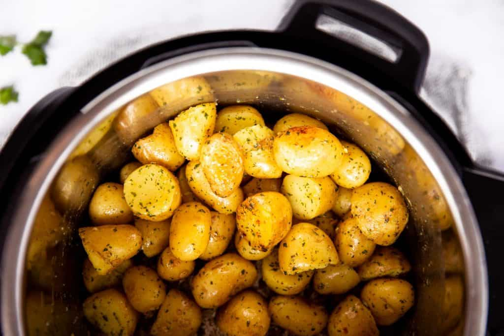top down view of an instant pot filled with baby potatoes