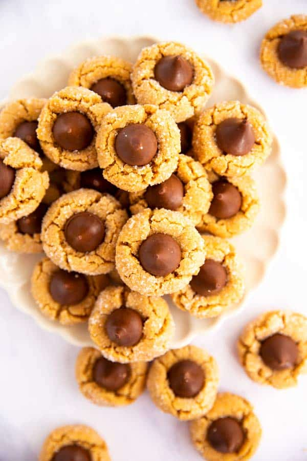 plate of peanut butter cookies with chocolate kisses from the top down