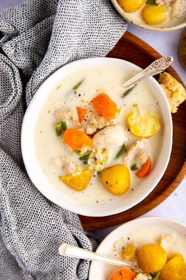 three bowls of turkey soup on a bright surface