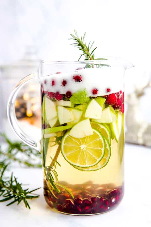 pitcher filled with white Christmas sangria