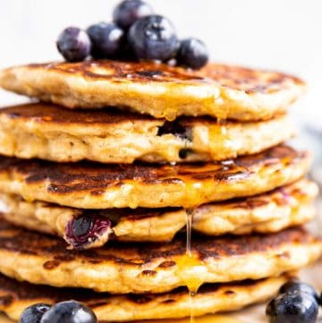 close up photo of a stack of blueberry oatmeal pancakes