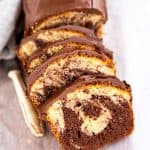 sliced marble pound cake on a wooden board