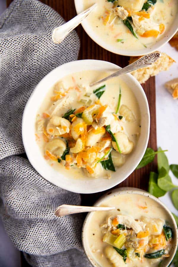 three bowls with Olive Garden copycat chicken gnocchi soup
