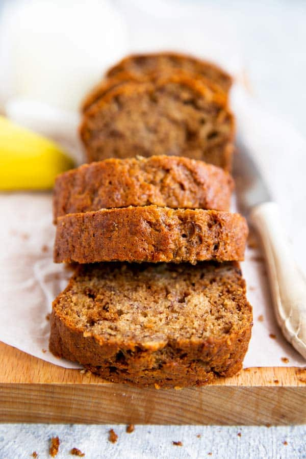 slices of banana bread on a wooden board