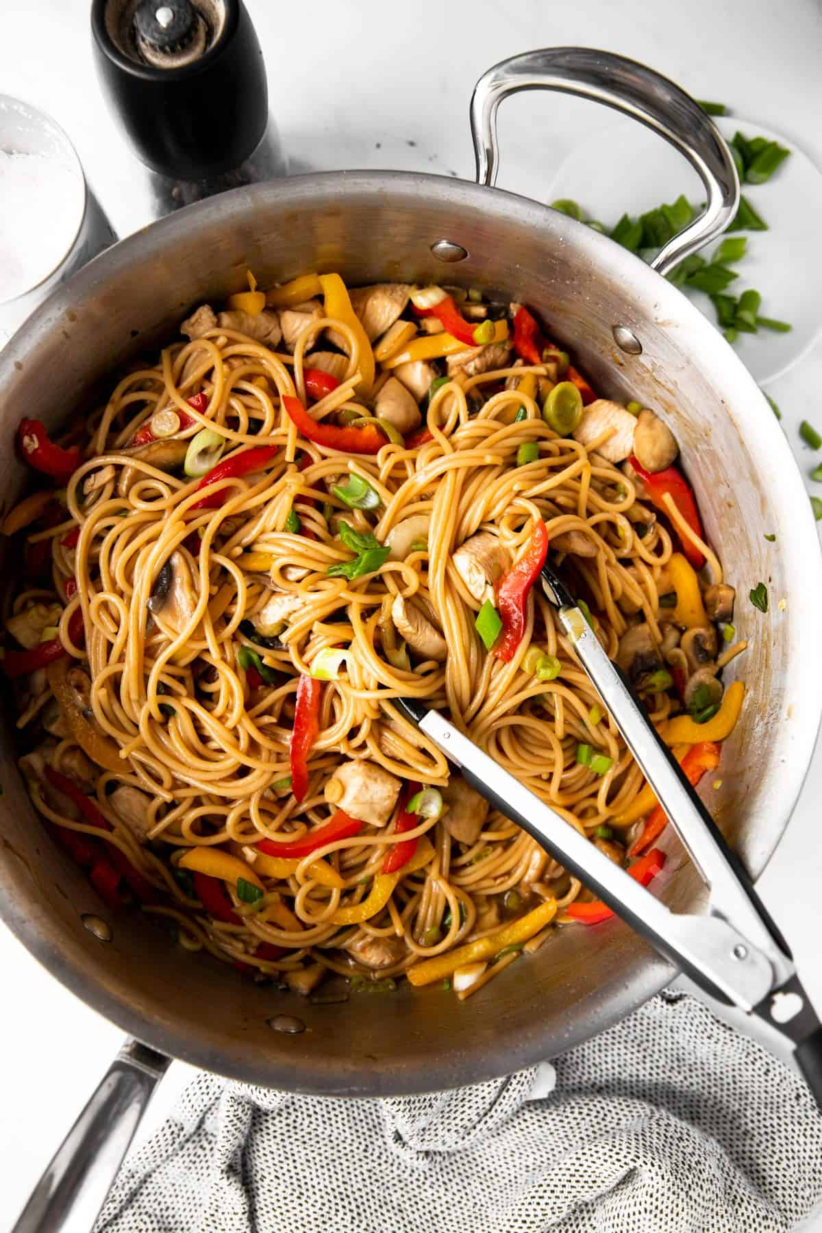 overhead photo of skillet filled with chicken lo mein