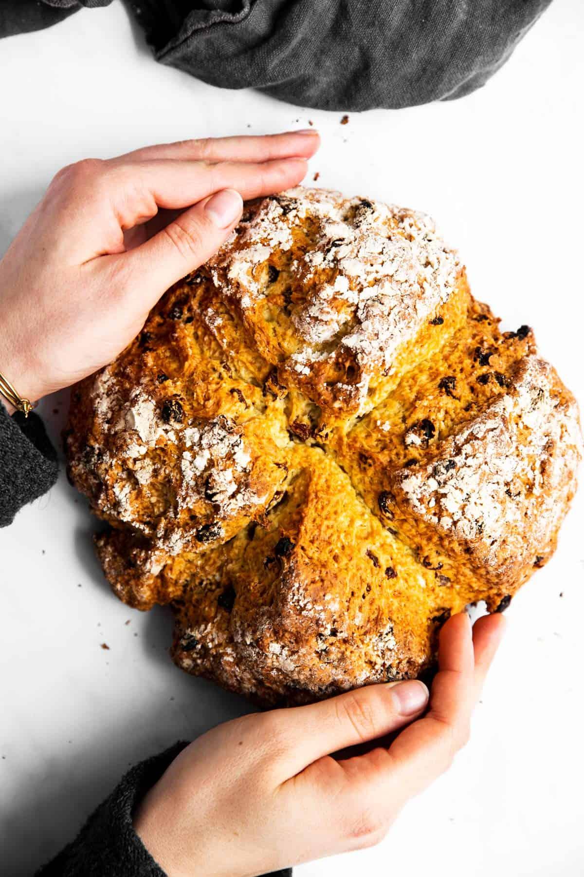 woman holding a loaf of Irish soda bread