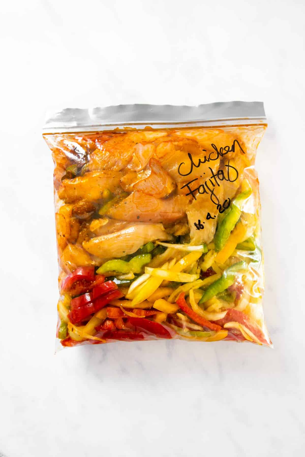 freezer bag filled with ingredients for chicken fajitas