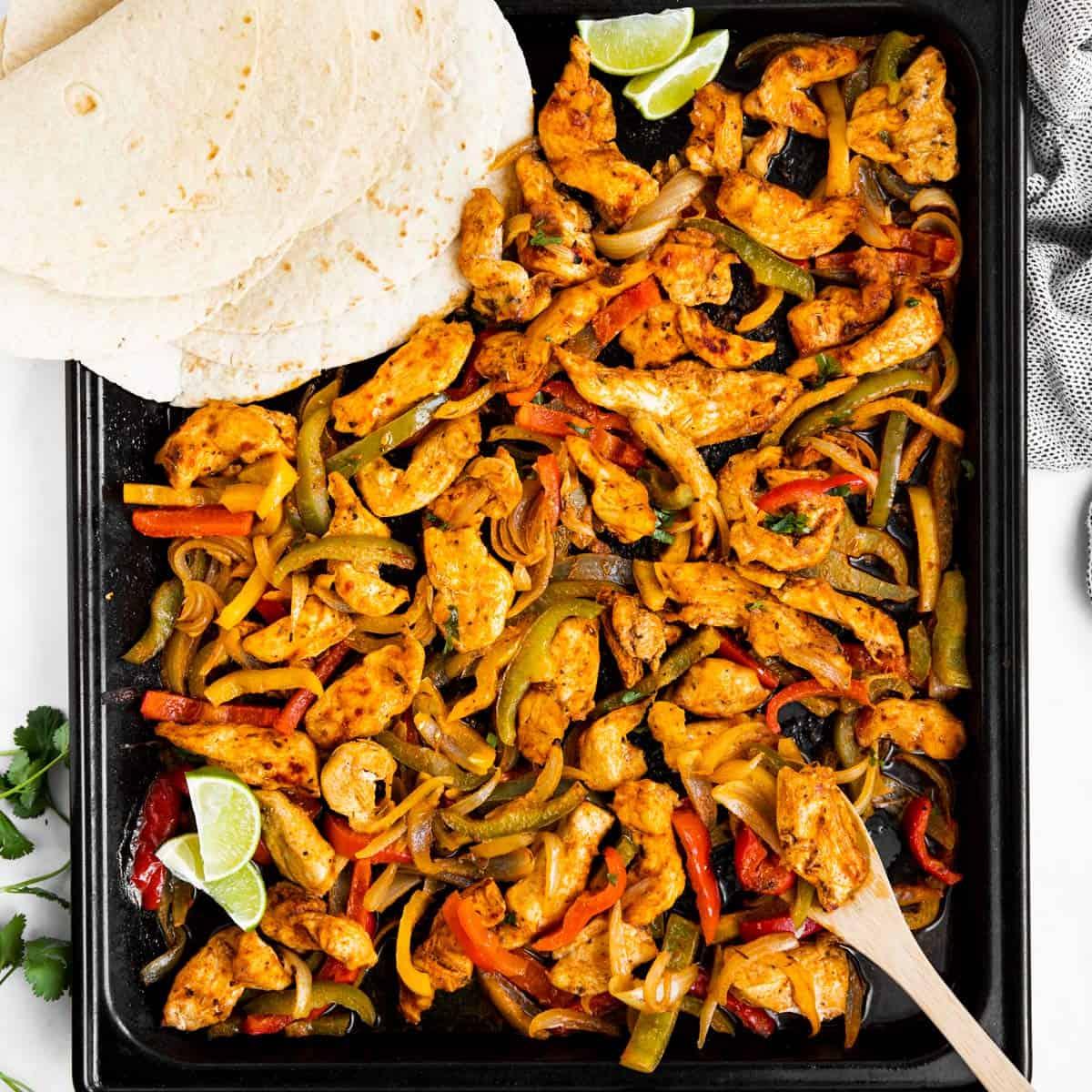 top down view on sheet pan with fajita chicken