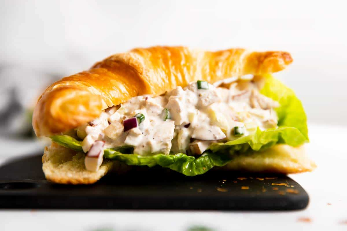 frontal view of croissant filled with chicken salad