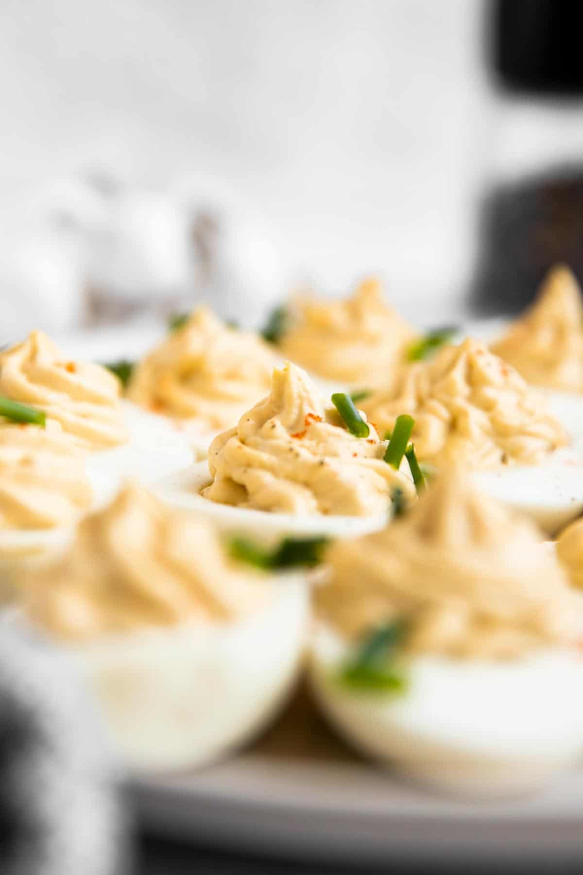 selective focus photo of a plate with deviled eggs