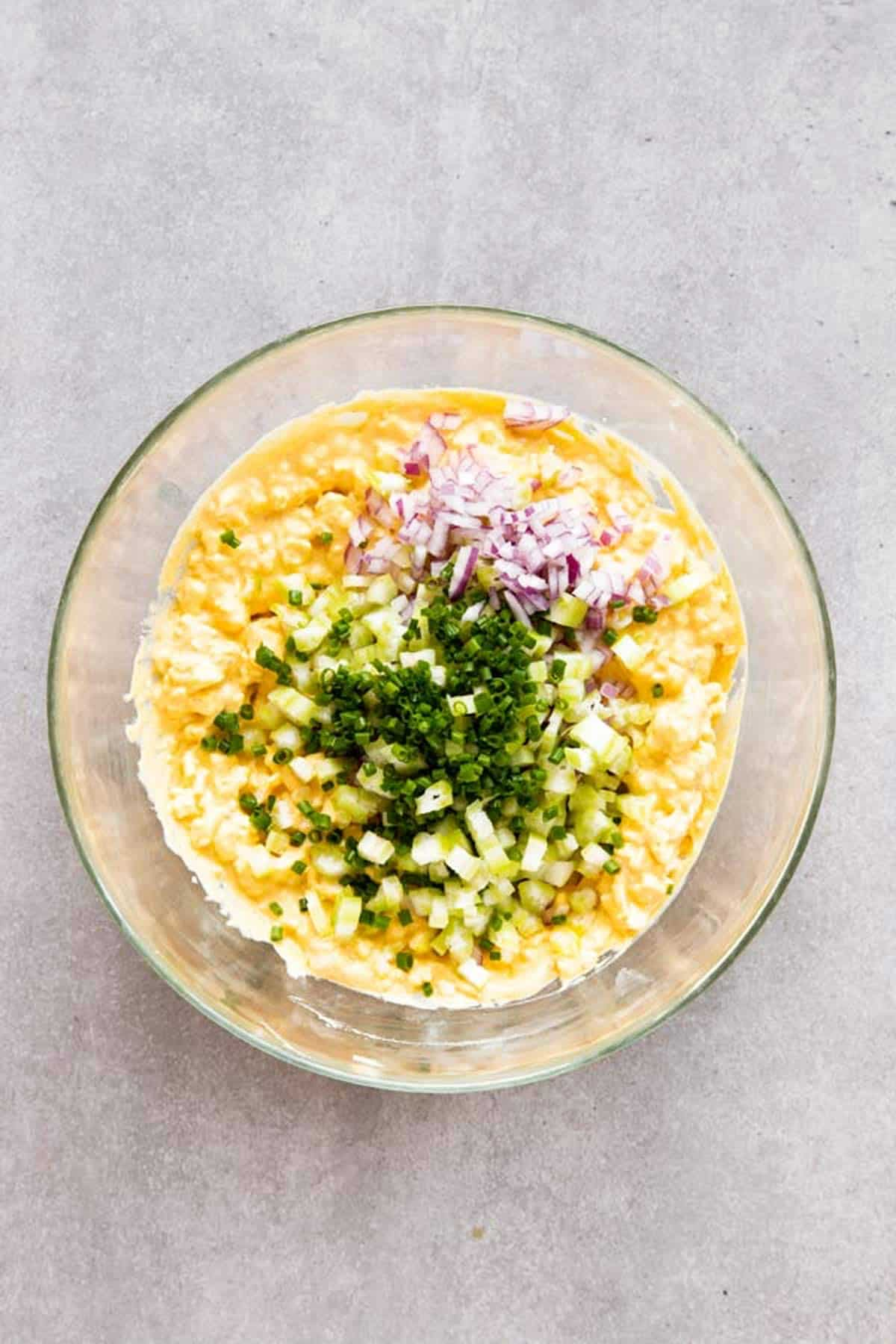top down view on bowl with ingredients for egg salad