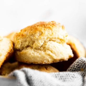 close up photo of a biscuit in a basket