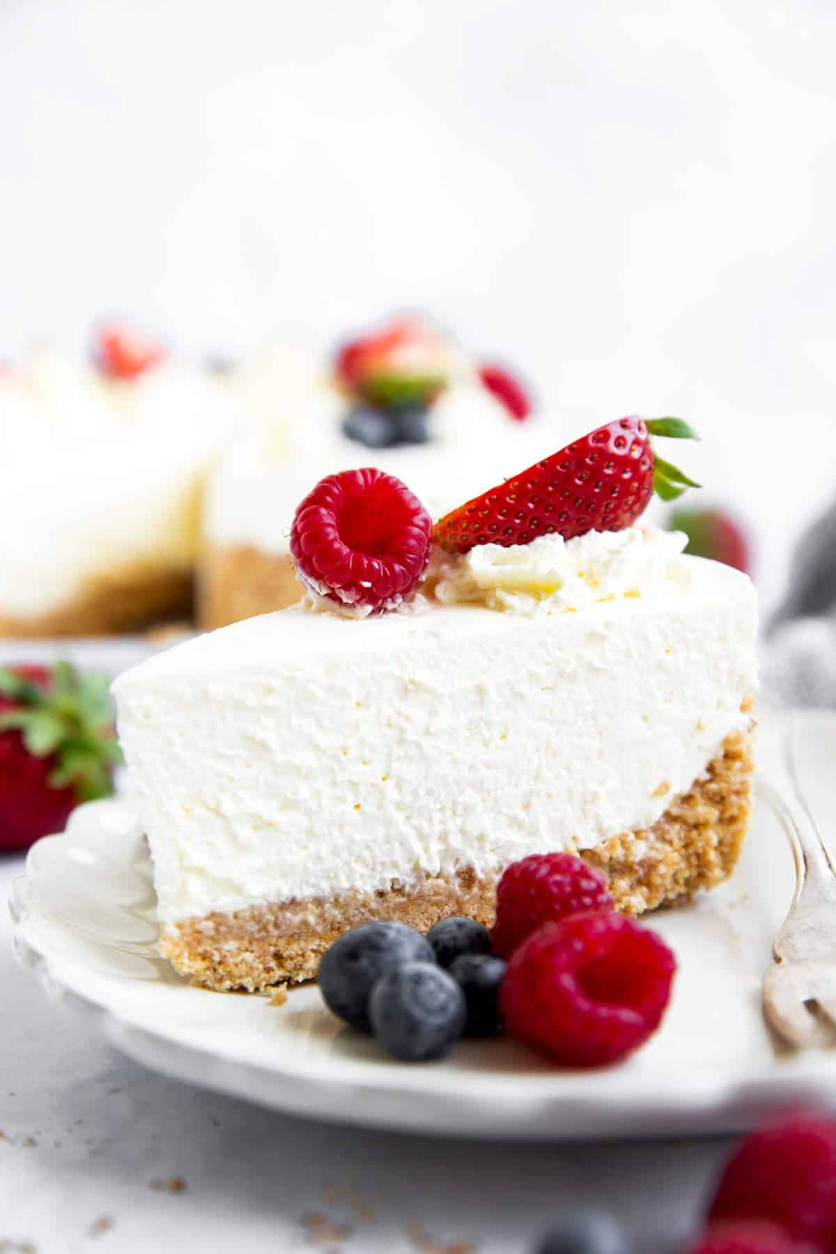 slice of no bake cheesecake with berries
