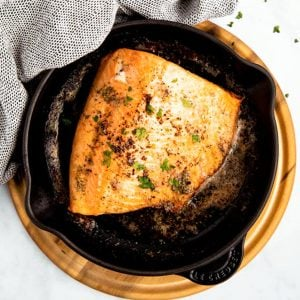 top down view on salmon fillet in black skillet
