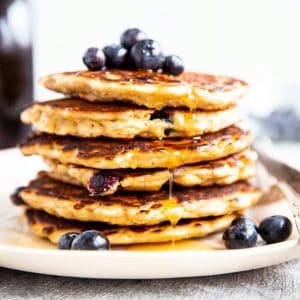 frontal view of stack of blueberry oat pancakes