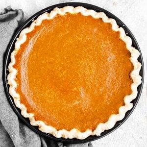 top down view on pumpkin pie in black pie dish