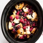 overhead view on raspberry French toast bake in black crockery dish