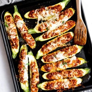 top down view on sheet pan with zucchini boats