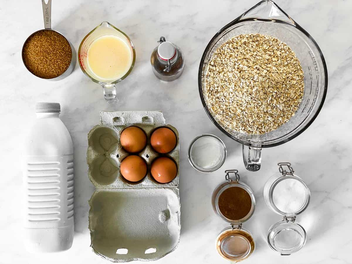 ingredients for baked oatmeal on a marble surface