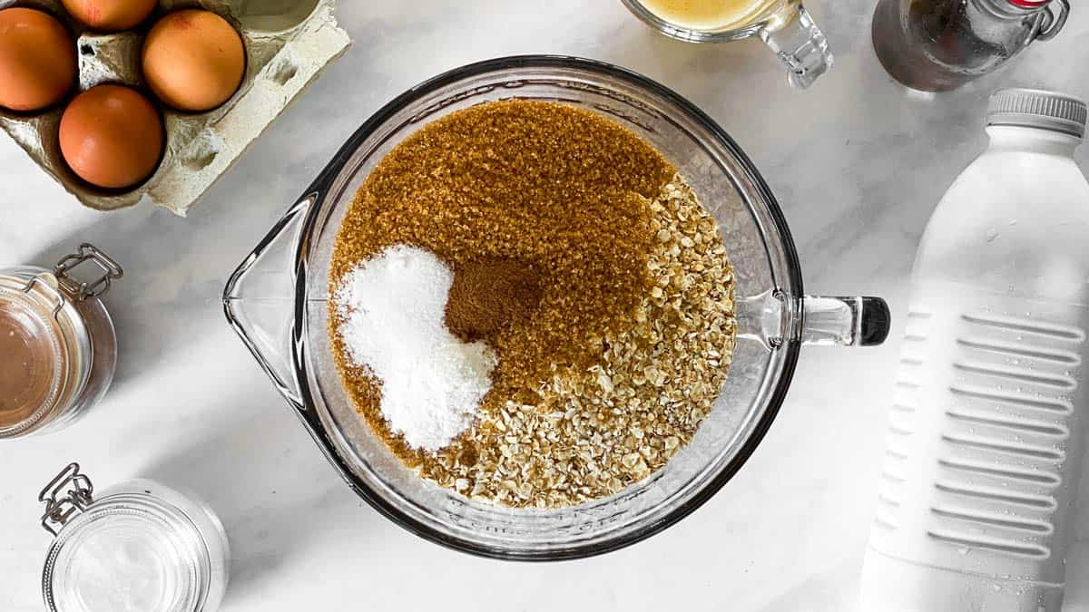 dry ingredients for baked oatmeal in a glass bowl