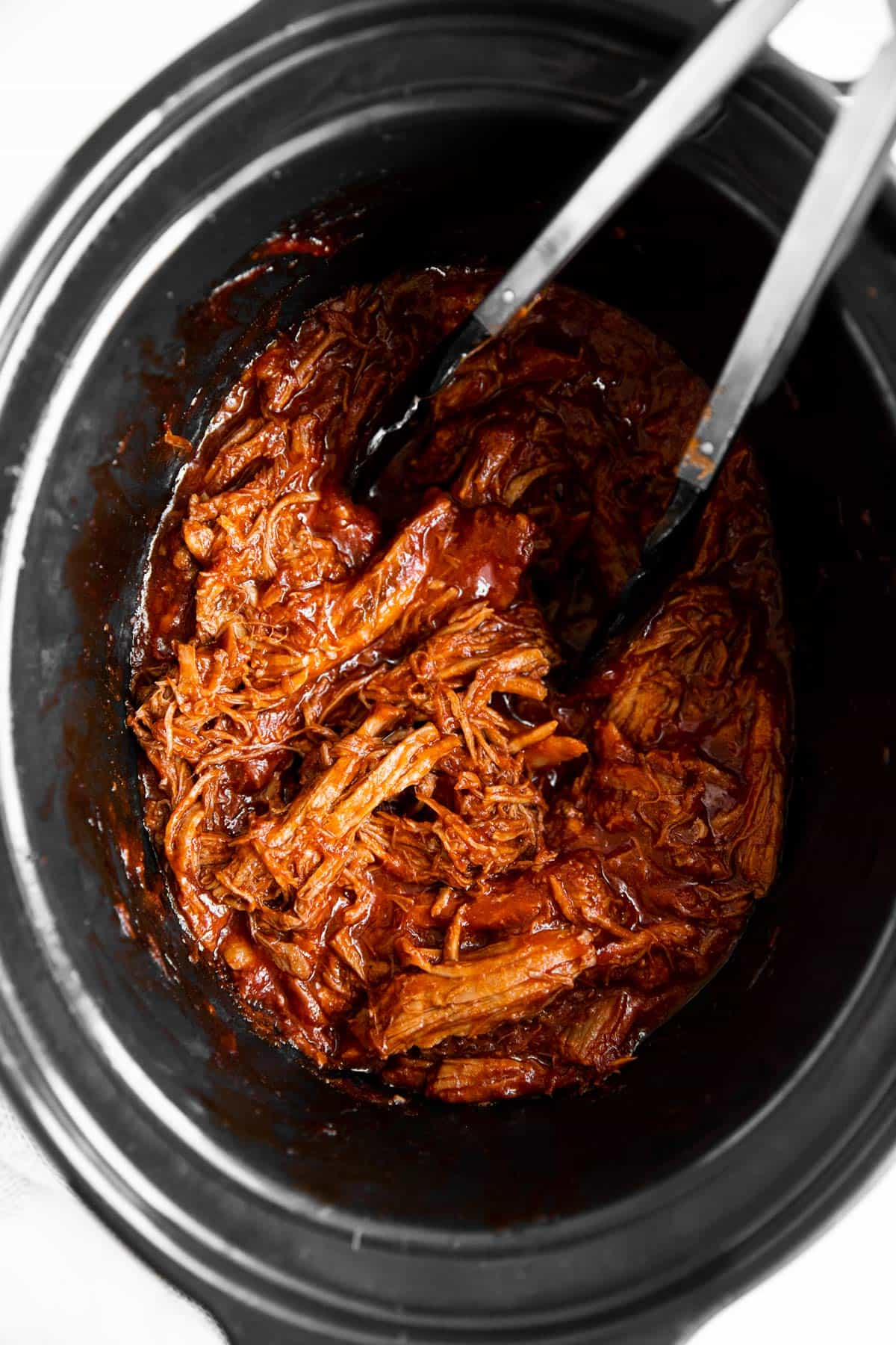 overhead view of crockpot with BBQ pulled pork