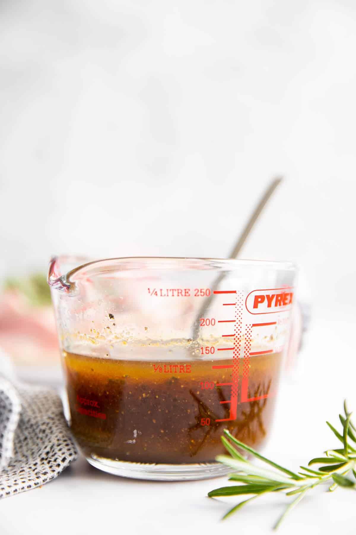 measuring jug with pork chop marinade