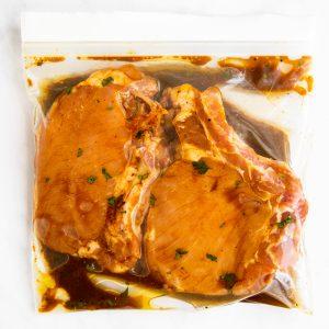 ziploc bag with marinated pork chops